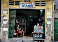 Roadside artisans, shops and taverns in Hanoi, Vietnam