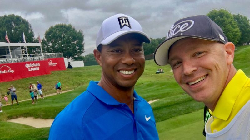 Tiger Woods shares special experience with military caddie at the Quicken Loans National