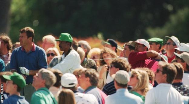 Tiger Woods and Nick Faldo on course