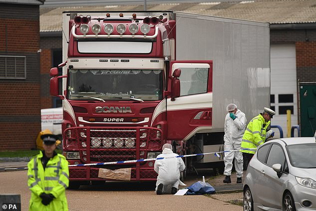 Six people charged over the deaths of the 39 migrants who were found in a lorry in Essex (pictured) in October appeared at the Old Bailey today